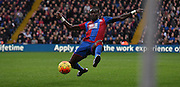 Pape Souare lunging for the ball during the Barclays Premier League match between Crystal Palace and Swansea City at Selhurst Park, London, England on 28 December 2015. Photo by Michael Hulf.