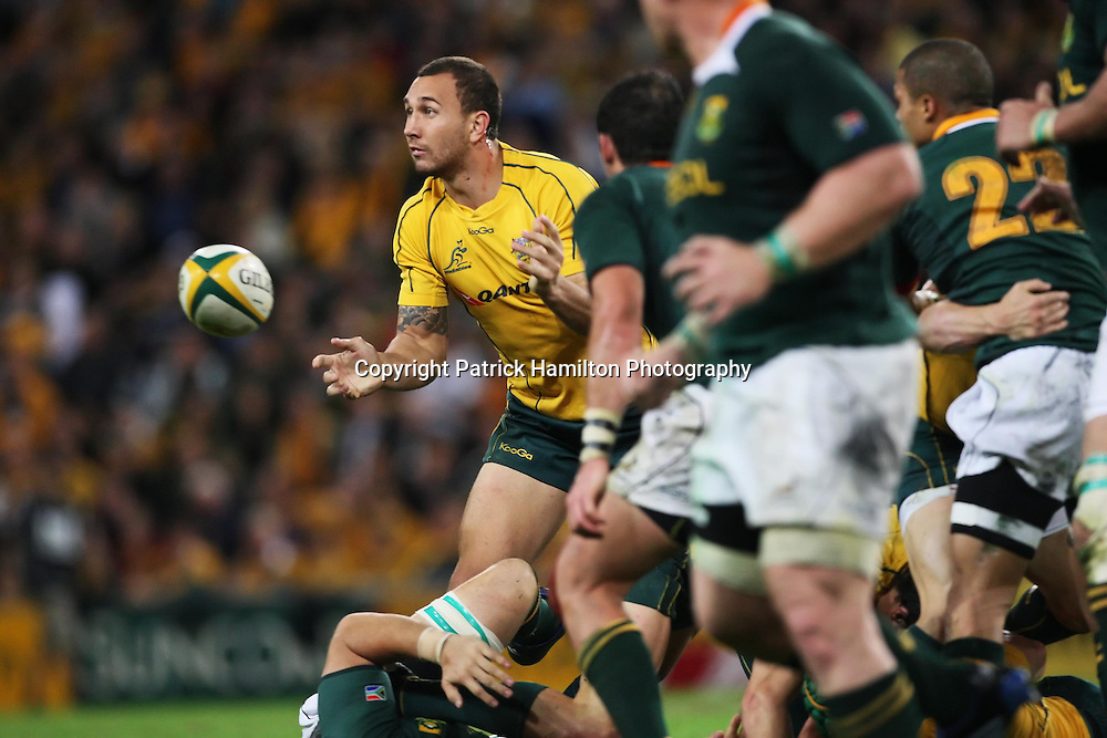 Quade Cooper gets a pass away during the Tri-Nations rugby Test at Suncorp Stadium in Brisbane,  July 24, 2010.The Wallabies again ran the world champion Springboks into submission to win the second Tri-nations rugby Test 30-13 .