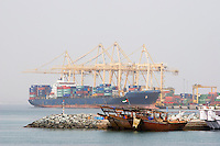 Khor Fakkan UAE Large cargo ships docked to load and unload goods at Khor Fakkport