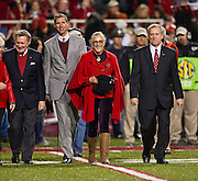 Nov 12, 2011; Fayetteville, AR, USA;  Arkansas chancellor David Gearhart walks with director of Crystal Bridges Museum Don Bacigalupi museum founder Helen Walton and athletic director Jeff Long during a time out of the Arkansas Razorbacks versus Tennessee Volunteers game at Donald W. Reynolds Razorback Stadium. Arkansas defeated Tennessee 49-7. Mandatory Credit: Beth Hall-US PRESSWIRE