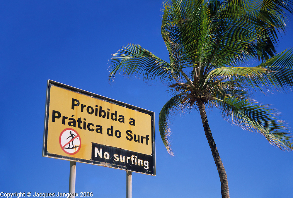 Bilingual Portuguese - English sign saying No Surfing at Boa Viagem Beach, Recife, Pernambuco, Brazil