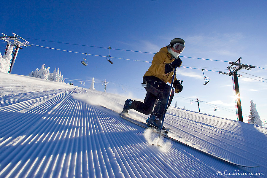 Lisa Jones telemarking skiing on the corduroy at Whitefish Mountain Resort in Montana model released
