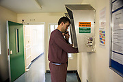 A prisoner makes a call home to family. HMP/YOI Portland, Dorset. A resettlement prison with a capacity for 530 prisoners. Dorset, United Kingdom.