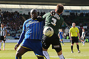 Bayo Akinfenwa forward for AFC Wimbledon (10) and Plymouth Argyle defender Gary Sawyer (3) tussle during the Sky Bet League 2 match between Plymouth Argyle and AFC Wimbledon at Home Park, Plymouth, England on 9 April 2016. Photo by Stuart Butcher.