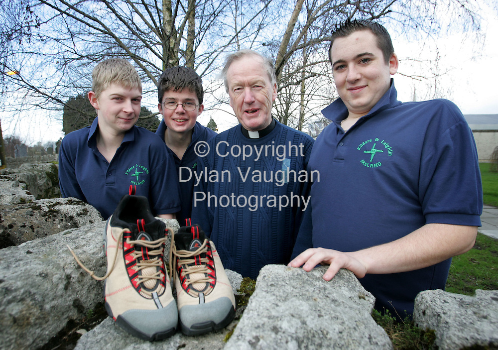 21/2/2006.The Bishop Jim Moriarty of the Diocese of Kildare and Loughlin pictured at Tullow Community School with students from left Dwane Tobin, Owen McGill and Jason Kelly with the walking shoes the bishop wore at the world youth day in Cologne in Germany last August..Picture Dylan Vaughan.