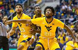 Dec 23, 2016; Morgantown, WV, USA; West Virginia Mountaineers forward Brandon Watkins (20) boxes out Northern Kentucky Norse forward Jordan Garnett (1) during the first half at WVU Coliseum. Mandatory Credit: Ben Queen-USA TODAY Sports