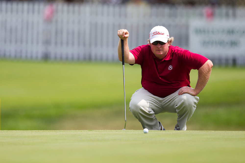 Brad Fritsch attempts to read the break in the 18th green during the final round of the 2012 Price Cutter Charity Championship at Highland Springs Country Club on August 12, 2012 in Springfield, Missouri. (David Welker/www.TurfImages.com).