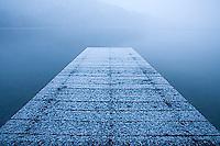 Snow covered dock on Fallen Leaf Lake. Lake Tahoe, CA