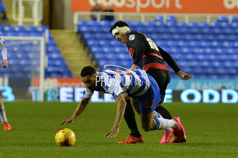 Reading's Nick Blackman brought down on the edge of the box by Queens Park Rangers midfielder Leroy Fer during the Sky Bet Championship match between Reading and Queens Park Rangers at the Madejski Stadium, Reading, England on 3 December 2015. Photo by Mark Davies.