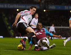 LONDON, ENGLAND - Wednesday, January 30, 2008: Liverpool's Steve Finnan and West Ham United's Luis Boa Morte during the Premiership match at Upton Park. (Photo by David Rawcliffe/Propaganda)