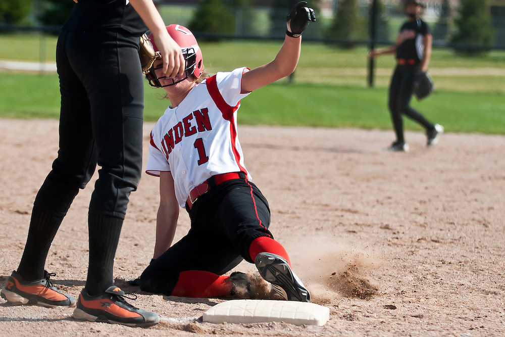 Lathan Goumas | MLive.com..May 3, 2012 - Kaitlyn Dunleavy of Linden High School slides into third during the first game of a double header against Clio High School at Linden High School in Argentine Township on Thursday.