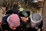 A fighter from the Free Syrian Army is helped after he was hit by sniper fire from the government Army in Rankous, around 30km north of Damascus, Syria. January 28, 2012. Photo/Tomas Munita