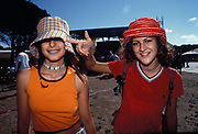 Two smiling women wearing colourful clothes and hats, Istanbul, Turkey.
