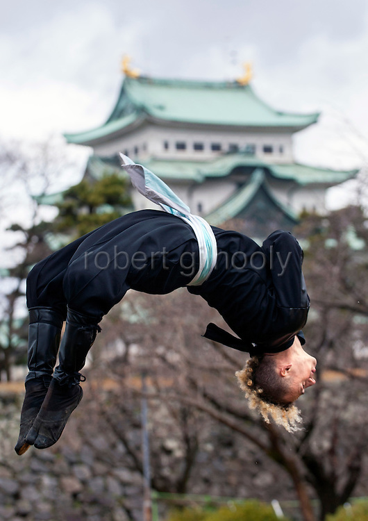 """Ninja Chris  """"Sora"""" O'Neil performs a backflip in the grounds of Nagoya Castle, Aichi Prefecture Japan on Feb. 23, 2017. O'Neil is one of the eight ninja corps who roam the avenues of the castle and Nagoya Airport, jumping from behind trees and bushes to surprise visitors. ROB GILHOOLY PHOTO"""