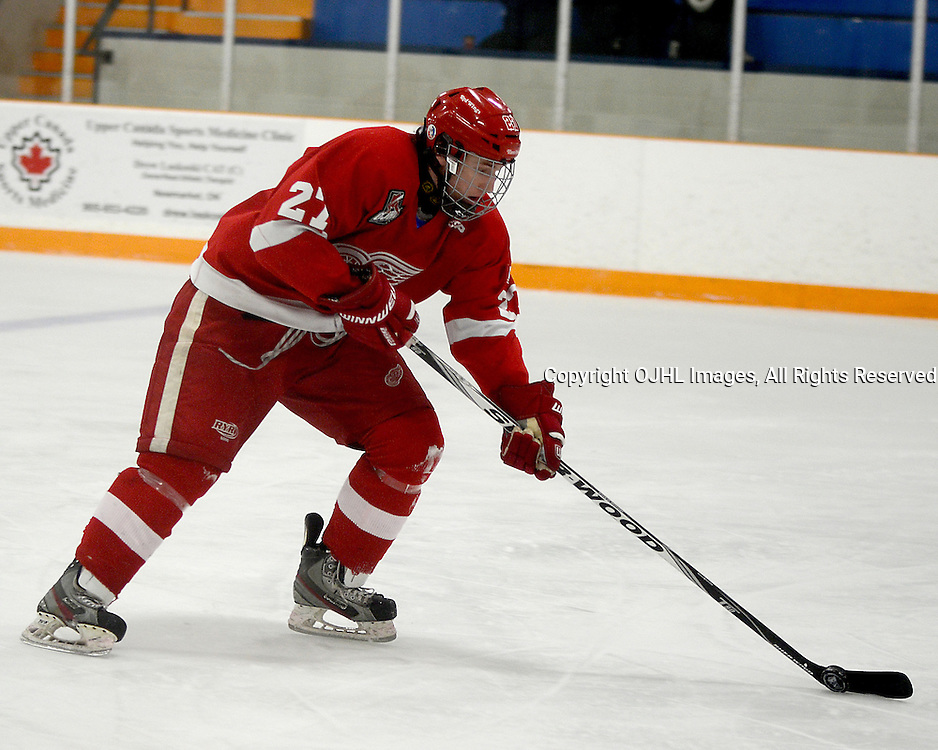 STOUFFVILLE, ON - Feb 2 : Ontario Junior Hockey League Game Action between the Stouffville Spirit Hockey Club and the Hamilton Red Wings Hockey Club.  Mitch Reid #27 of the Hamilton Red Wings Hockey Club skates with the puck during third period game action.<br /> (Photo by Michael DiCarlo / OJHL Images)