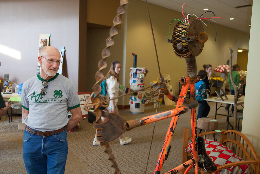 Redge Wilde views the variety of art pieces created from recycled parts at the Appalachian Ohio ReUse Competition on Earth Day.  Photo by Ohio University / Jonathan Adams