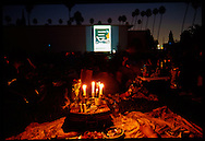 Cinespia features mid-century movies projectd on to the wall of the marble mausoleum wall.  Movie goers are encouraged to bring picnic dinners and wine or beer to enjoy while watching the entertainment.