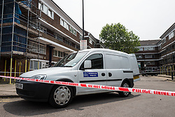28/05/2016. London, UK. Police forensic investigators examine the scene on Payne Street, Deptford, where a 16-year-old boy was stabbed repeatedly. The victim's condition is said to be 'critical', and a police cordon remains in place as investigations continue. Photo credit: Rob Pinney