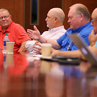 Guntown Mayor Bud Herring listens to fellow mayors discuss the overcrowding at the Lee County Jail.