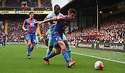 Scott Dann holds the ball up from Diafra Sakho during the Barclays Premier League match between Crystal Palace and West Ham United at Selhurst Park, London, England on 17 October 2015. Photo by Michael Hulf.