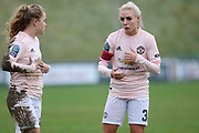 Manchester United Women FC midfielder Alex Greenwood (3) gestures to ManchesterUnited Women FC midfielder Charlie Devlin (14) during the FA Women's Championship match between Lewes Women FC and Manchester United Women FC at the Dripping Pan, Lewes, East Sussex, United Kingdom on 2 December 2018.