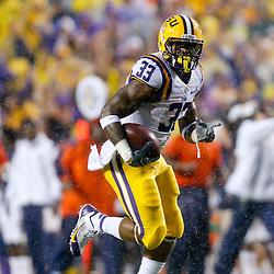 Sep 21, 2013; Baton Rouge, LA, USA; LSU Tigers running back Jeremy Hill (33) against the Auburn Tigers during the first half of a game at Tiger Stadium. Mandatory Credit: Derick E. Hingle-USA TODAY Sports