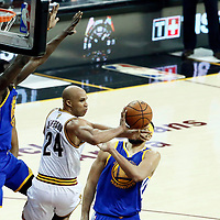 09 June 2017: Cleveland Cavaliers forward Richard Jefferson (24) passes the ball past Golden State Warriors center JaVale McGee (1) during the Cleveland Cavaliers 137-11 victory over the Golden State Warriors, in game 4 of the 2017 NBA Finals, at  the Quicken Loans Arena, Cleveland, Ohio, USA.