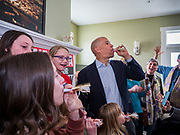 """31 DECEMBER 2019 - ANKENY, IOWA: US Senator CORY BOOKER (D-NJ) blows a noise maker following the """"Happy Noon Year"""" countdown after he made a speech at a campaign house party in Ankeny, a suburb of Des Moines. The family that hosted Sen. Booker does a """"Noon Year"""" countdown with their children every year. Sen Booker is campaigning in Iowa over New Years to support his candidacy for the US Presidency. Iowa traditionally holds the first event of the presidential election cycle. The Iowa caucuses are Feb. 3, 2020.          PHOTO BY JACK KURTZ"""