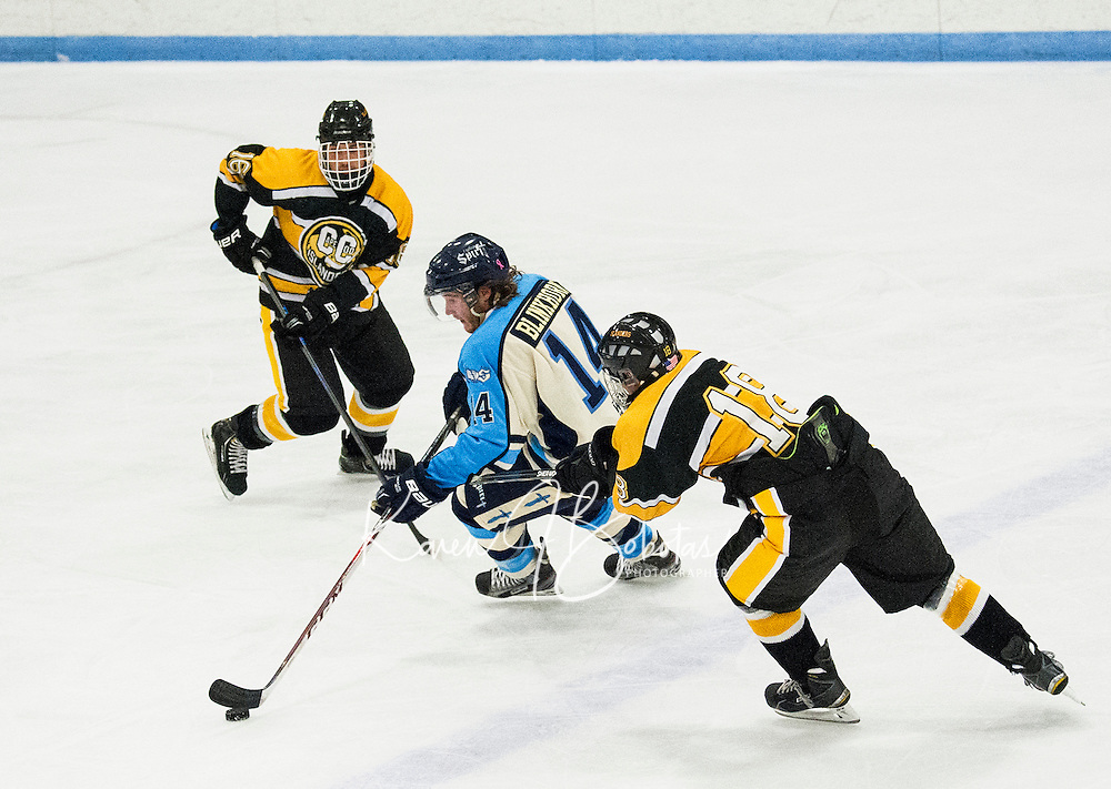 NH's Fighting Spirit's Travis Blinkhorn cuts between Brandon Robert and Mack O'Shea of the Cape Cod Islanders during Junior A Hockey at the Laconia Ice Arena Friday evening.  (Karen Bobotas/for the Laconia Daily Sun)