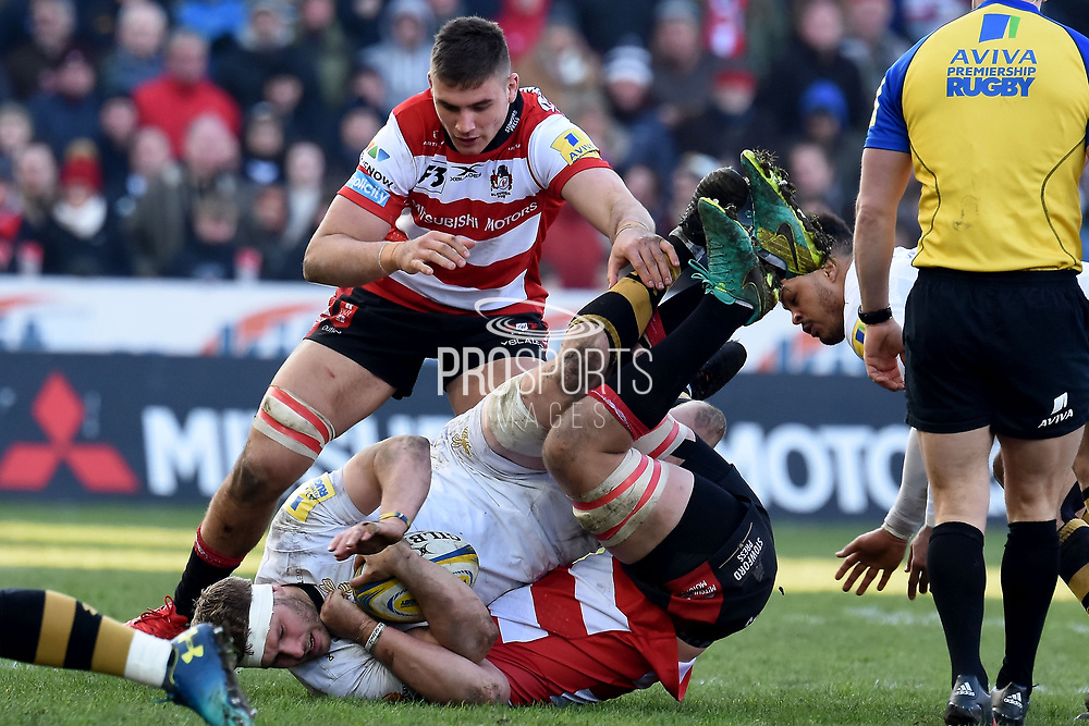 Wasps back Row Thomas Young tackled during the Aviva Premiership match between Gloucester Rugby and Wasps at the Kingsholm Stadium, Gloucester, United Kingdom on 24 February 2018. Picture by Alan Franklin.