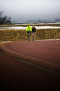 Dan Letche and kevin Brady biking in rain and fog South of Vermillion, SD on March 10, 2010..