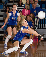Jenna Stone bumps a serve watched by her teammate Kelsey Clark during the GHS Homecoming Volleyball game against Souhegan Saturday evening.  Gilford was victorious with three wins.  (Karen Bobotas/for the Laconia Daily Sun)