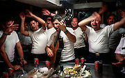 ATLANTIC OCEAN-- The B.E. Esmeralda is the Chilean Navy's training ship.  One of several tall ships to participate in Opsail, the Esmeralda is the largest in the regatta.....The kitchen staff sings songs at a birthday party for three of its members