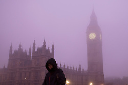 © licensed to London News Pictures. London, UK 16/10/2013. People commuting in Westminster, London through heavy fog on Wednesday, 16 October 2013. Photo credit: Tolga Akmen/LNP