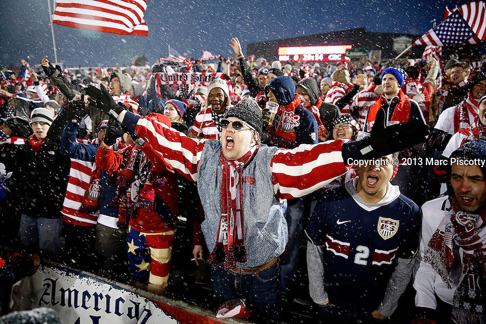 SHOT 3/22/13 6:19:50 PM - United State's soccer fan Rob Wexhell (center) of New York, N.Y. cheers with fellow fans during a World Cup qualifying game against Costa Rica at Dick's Sporting Goods Park in Commerce City, Co. on Friday March 22, 2013. The U.S. won the game 1-0 in a spring blizzard that blanketed the pitch and fans in snow. Wexhell said he has now been to more than 25 U.S. soccer team games to cheer the team on. (Photo by Marc Piscotty / © 2013).