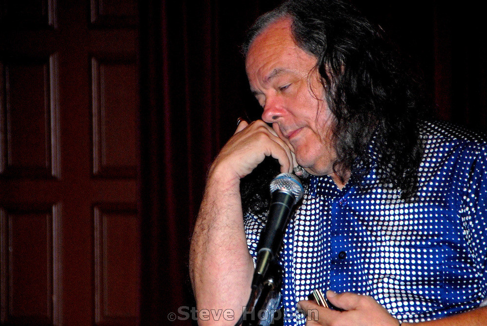 David Lindley performing at the Cactus Cafe, Austin Texas, August 15 2008. David Lindley (b. 1944, San Marino, California) is an American guitarist and multi-instrumentalist including banjo, kettle drums, lap steel guitar, violin, oud, cittern, bouzouki, saz, and cümbüş. During 1966 to 1970 he was part of the psychedelic band Kaleidoscope. He is a session musician and has played with Jackson Browne, Warren Zevon, Linda Ronstadt, Curtis Mayfield, James Taylor, David Crosby, Graham Nash, Bob Dylan, Rod Stewart and Ben Harper. The Cactus Cafe is a well-known music venue on the campus of the University of Texas at Austin.