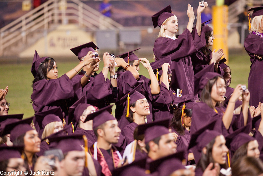 13 MAY 2009 -- TEMPE, AZ:  Students applaud and photograph Pres. Obama. President Barack Obama addressed the Arizona State University class of 2009 during the commencement program in Sun Devil Stadium in Tempe Wednesday evening.    PHOTO BY JACK KURTZ