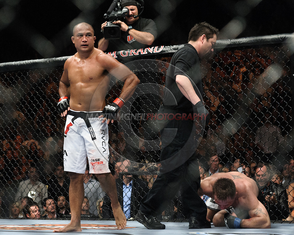 "LAS VEGAS, NEVADA, MAY 24, 2008: BJ Penn (left) walks away from a downed Sean Sherk, securing a TKO victory and thus retaining his lightweight championship title during ""UFC 84: Ill Will"" inside the MGM Grand Garden Arena in Las Vegas"