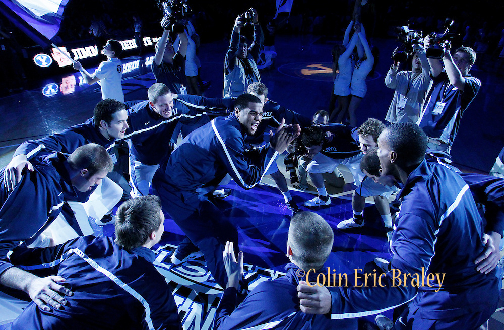 The BYU Cougars, led by forward Brandon Davies, center, chant before an NCAA college basketball game against Utah in Provo, Utah, Saturday, Feb. 12, 2011. (AP Photo/Colin E Braley)
