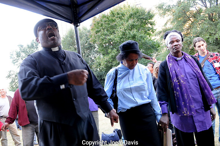 "October 15, 2011 - ""Together we stand,"" said Bishop Michael Robinson of Almighty Movement of God in Ministries about his church group and Occupy Atlanta after his group constructed a sanctuary space in Woodruff Park amongst the Occupy Atlanta tents."