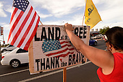 """About 30 members of the Tucson Tea Party Coalition protest what the coalition says is """"the unholy alliance of Barack H. Obama, Jan Brewer, special interests, and turncoat Republicans,"""" regarding """"OBrewercare/Obamacare/Medicaid Expansion in Arizona"""" on June 21, 2013 in Tucson, Arizona, USA."""