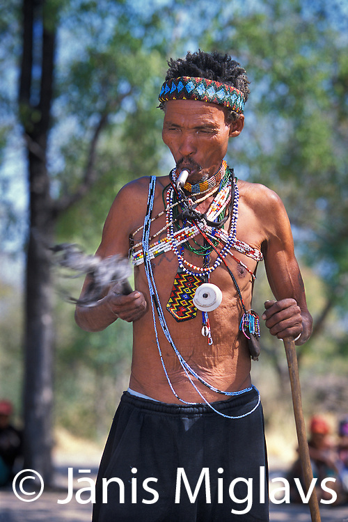 A San (Bushman) witch doctor performs a ceremony to enter a trance, Namibia, Africa.