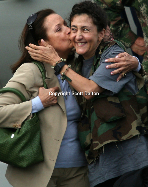Ingrid Betancourt, who was help captive by FARC rebels for over 6 years, is kissed by her mother upon her arrival to Bogotá after being rescued in a Colombian military operation on July 2, 2008. (Photo/Scott Dalton).
