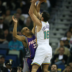 Peja Stojakovic #16 shoots as Grant Hill #33 defends on February 26, 2008 at the New Orleans Arena in New Orleans, Louisiana. The New Orleans Hornets defeated the Phoenix Suns 120-103.