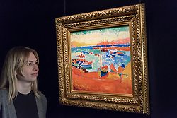 © Licensed to London News Pictures. 22/02/2018. LONDON, UK. A staff member views ''Bateaux À Collioure'' by André Derain, (Est. £7,500,000 - 10,000,000) at the preview of Sotheby's upcoming Impressionist, Modern & Surrealist Art auctions taking place at Sotheby's, New Bond Street, on 28 February. Photo credit: Stephen Chung/LNP