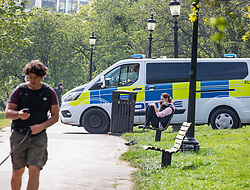 © Licensed to London News Pictures. 16/04/2020. London, UK. Police vans patrol Primrose Hill enforcing lockdown rules on social distancing and exercise. Meanwhile, Pret A Manger and other coffee shops in London start to reopen and Ministers consider when and how the lockdown will finish as politicians are warned that the UK could face the worst recession in 300 years. Photo credit: Alex Lentati/LNP