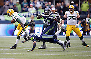 Green Bay Packers running back James Starks (44) high steps away from a diving tackle attempt by Seattle Seahawks free safety Earl Thomas (29) while chased by Seattle Seahawks defensive end Cliff Avril (56) as he runs for a fourth quarter gain of 32 yards to the Seattle Seahawks 43 yard line during the NFL week 20 NFC Championship football game against the Seattle Seahawks on Sunday, Jan. 18, 2015 in Seattle. The Seahawks won the game 28-22 in overtime. ©Paul Anthony Spinelli