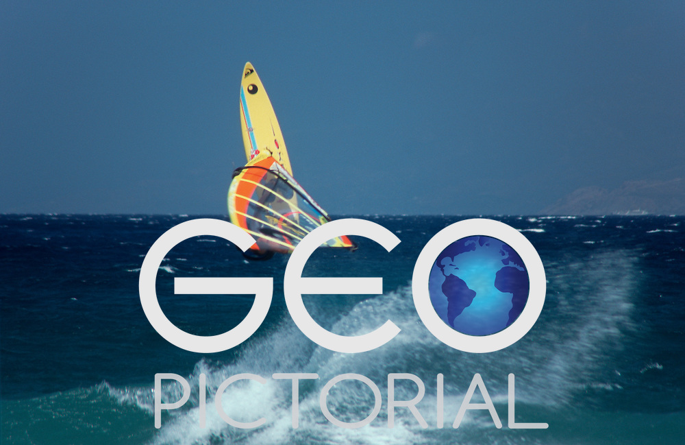 Robert Teriitehau windsurfing on Tsoukalia beach launches himself off a breaking wave, Paros, Cyclades Islands, Greece.