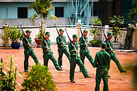 Vietnamese soldiers practice drills on a rooftop in downtown Saigon, Vietnam.