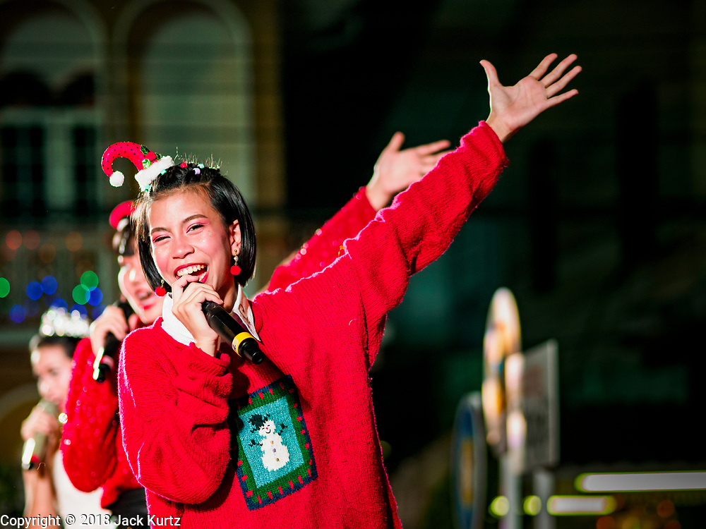 "23 DECEMBER 2018 - CHANTABURI, THAILAND: The Christmas show at the Cathedral of the Immaculate Conception's Christmas Fair in Chantaburi. Cathedral of the Immaculate Conception is holding its annual Christmas festival, this year called ""Sweet Christmas @ Chantaburi 2018"". The Cathedral is the largest Catholic church in Thailand and was founded more than 300 years ago by Vietnamese Catholics who settled in Thailand, then Siam.   PHOTO BY JACK KURTZ"